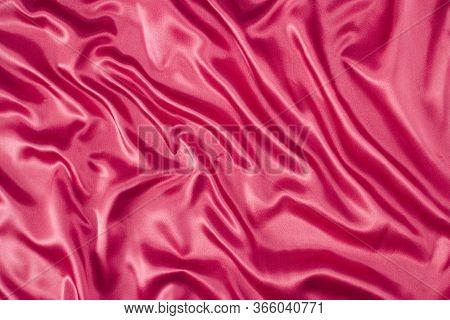 Bright Pink, Cerise Silk Folded Fabric Background, Luxurious Textile Decoration Backdrop, Background