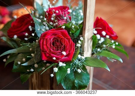 Wooden Bouquet . A Bouquet Of Roses In A Wooden Vase . Decorated Flowers Roses Bunch In Basket. Red