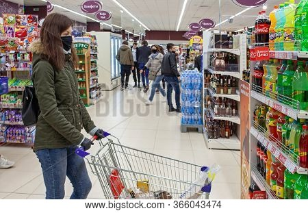 Minsk, Belarus - April 27, 2020: Buyer In Protective Mask And Rubbers Gloves With Shopping Cart In S
