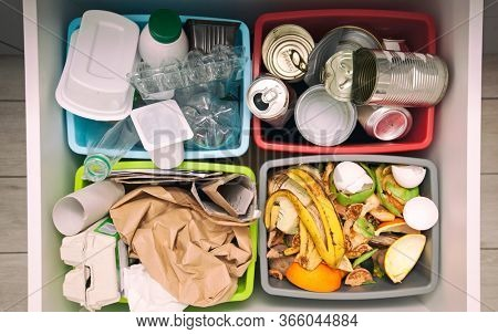 The four different container for sorting garbage. For plastic, paper, metal and organic waste
