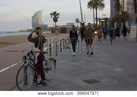 Barcelona, Spain, 02 May 2020. A Young Women With Bicycle Taking Photo In With Smartphone Of The Hot