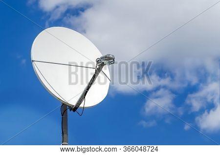 Satellite Dish Against Blue Sky. Close Up