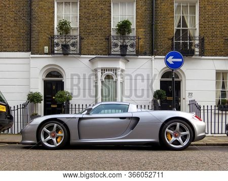 LONDON, UK - CIRCA MARCH 2013: A Porsche Carrera GT parked in the street. The Carrera GT is a mid-engined sportscar produced between 2004 and 2007.