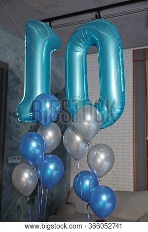 Ten-year-old Blue Balloon. White And Blue Balloons. Word 10 Written With Helium Blue Balloons . 10 Y
