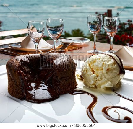 Chocolate fondant lava cake,  petit gateau, on the beach