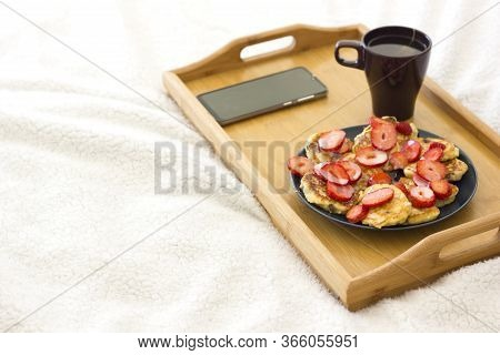 Breakfast Tray Set Up On A Bed With Healthy Foods And Drink On The White Background. Breakfast In Be