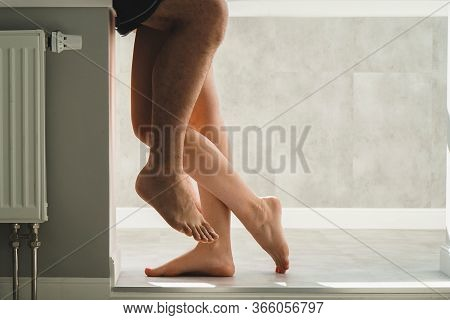Close-up Of The Feet Of Lovers. Lovers Hug Tightly. Place For Text Or Banner.