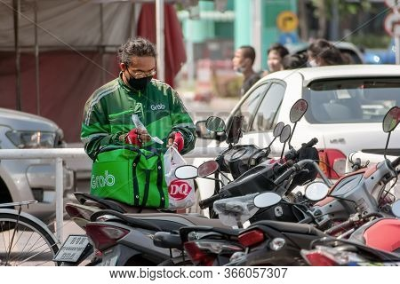 Bangkok, Thailand - May 10: Unnamed Grab Motorcycle Delivery Man Prepares To Deliver Dairy Queen Swe