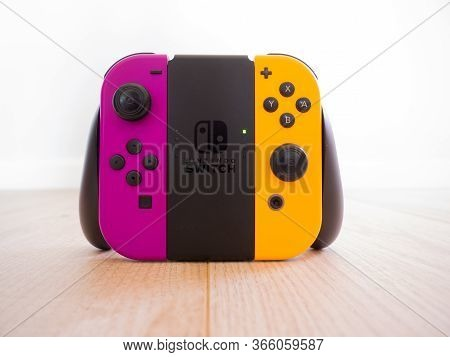 May 2020, Uk: Nintendo Switch Grip Controller With Orange And Purple Joy Con Remote Gaming