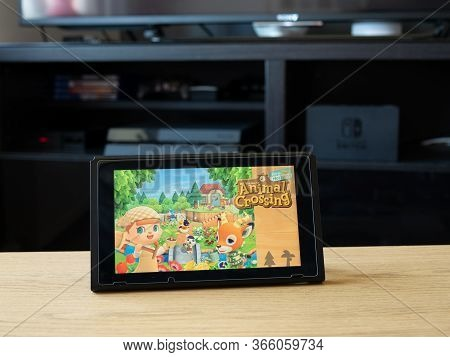 May 2020, Uk: Nintendo Switch On Table Top With Animal Crossing New Horizons Game
