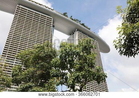Singapore, Republic Of Singapore - December 16, 2019: View To Marina Bay Sands Hotel At Marina Bay D