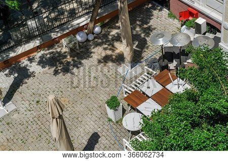 Thessaloniki, Greece - May 13 2020: Empty Outdoors Tables As Coronavirus Measures Affect Business &