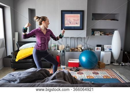 Positive Excited Woman Enjoying Exercising To Music, Dancing, Singing Near Yoga Mat And Fit Ball. Yo