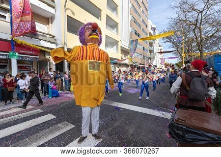 Loule, Portugal - February 25, 2020: Man Disguised As A Giant In The Street In Front Of The Public I