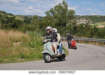 Couple Riding Vintage Scooter Vespa In The Italian Hills During The Rally Raduno Vespa E Lambretta,