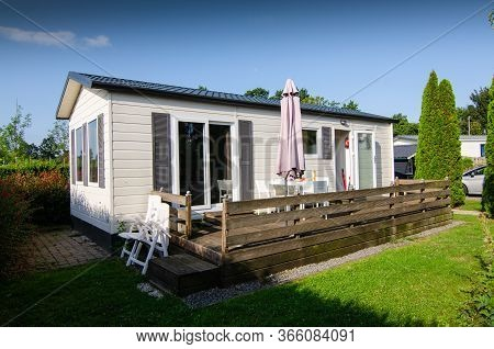 Netherlands, Zeeland Region. August 2019. A Nice Campsite Equipped With Bungalows. Outside The House