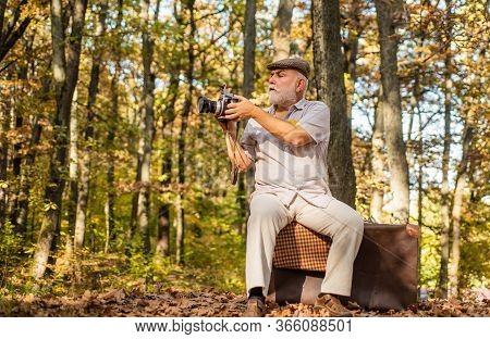Cameraman Outdoors. Professional Photographer. Pension Hobby. Retro Photographer. Used To Manual Set