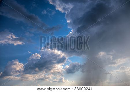 Raining Clouds With Rays Of Light