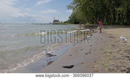 A Child Having Fun At The Cherry Beach, Toronto, Ontario, Canada