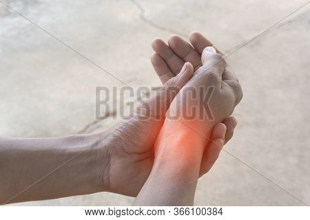 Closeup Of The Hand Of An Asian Man Who Is Suffering From Wrist Pain From Exercise, With His Left Ha