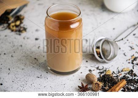 Lack Masala Chai Indian Tea With , Star Anise, Cinnamon, Cardamom, Nutmeg, Clove On White Table