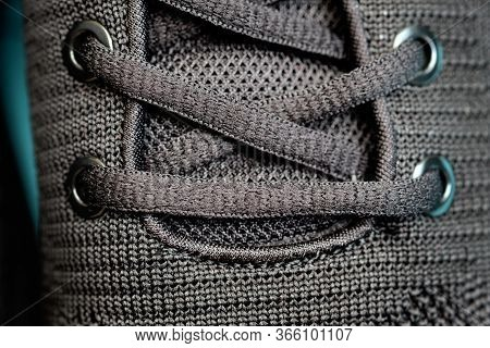 Black Laces On Sneakers, Holes For Laces Closeup. Eyelets On Black Mens Sneakers Top View. Durable L