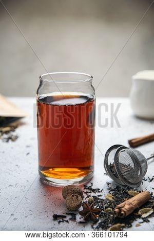 Black Tea With , Star Anise, Cinnamon, Cardamom, Nutmeg, Clove On White Table
