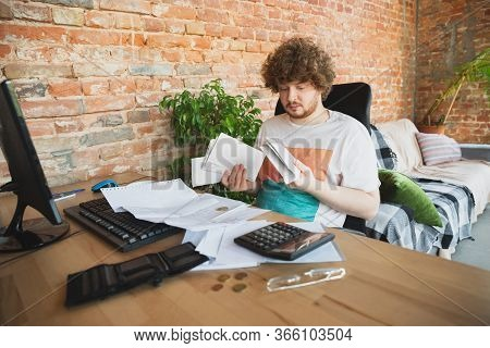 Caucasian Upset And Despair Man Doing Financial And Economical Reports With Income Going Down During