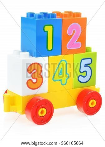 Childrens Plastic Construction Kit With Large Numbers Of Different Colors On A White Background. Stu