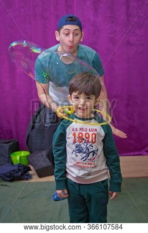 Soap Bubbles Show. Childrens Party. Kids Birthday . Playing With Soap Bubble At The Kids Birthday Pa