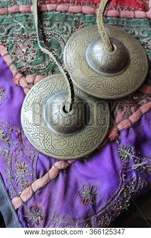 Tingsha (ting-sha), Tibetan Meditation Bells In Close Up, Laying On A Colorful Indian Cushion. Selec