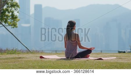 Woman do yoga at park
