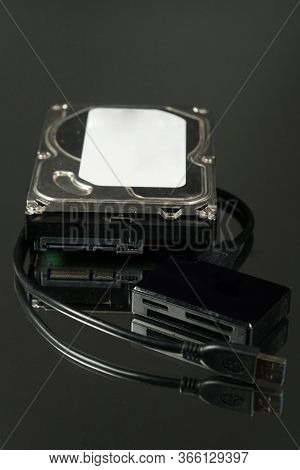 Universal Card Reader And Hard Drive Isolated On Black Mirror Background