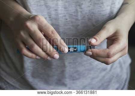 Diabetes Patient Turn Knob On End Of Insulin Pen And Dial Up Correct Insulin Dose For Injection