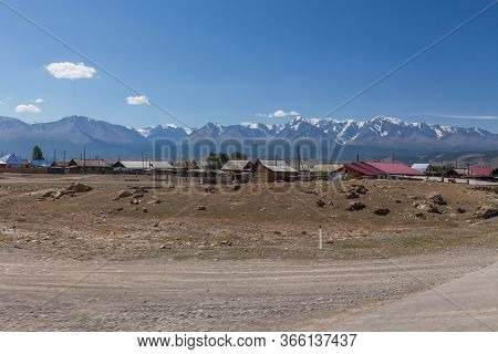 Village At The Foot Of Belukha Mountain. Altai Russia.