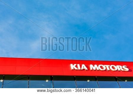 Kia Motors Corporation Brand Logo On Bright Blue Sky Background Located On Its Dealer Office Buildin