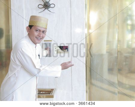Bellboy Or Concierge Standing At Front Of Lift