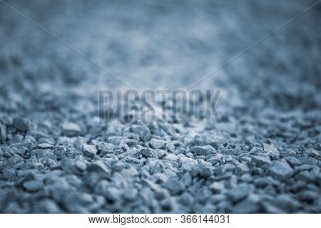 Background Of Pebbles. Pebble Texture With A Blue Tint. Decorative Rocks. Blue Stone Floor In The Ga