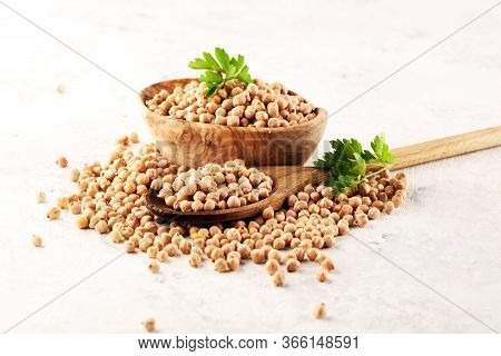 Raw Chickpeas On A Bowl. Chickpeas Is Nutritious Food. Healthy And Vegetarian
