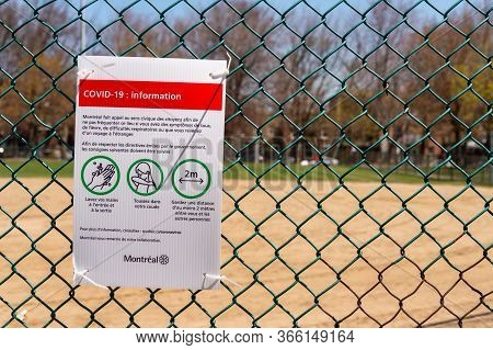 Montreal, Ca - 13 May 2020 : Sign Showing French Covid-19 Safety Guidelines At The Laurier Park