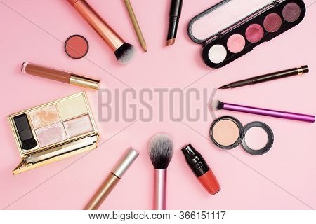 Makeup In Close View. A Lot Of Cosmetics For Woman On The Backgroud. Cosmetics Is Stacked In A Circl