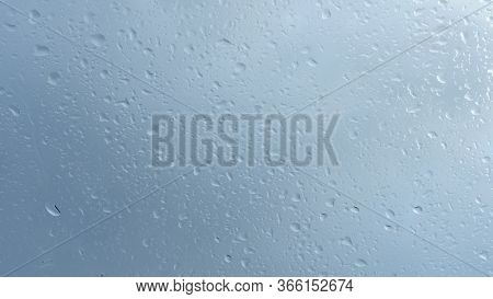 Close Up View Of Water Drops Falling On Glass. Rain Running Down On Window. Rainy Season, Autumn. Ra