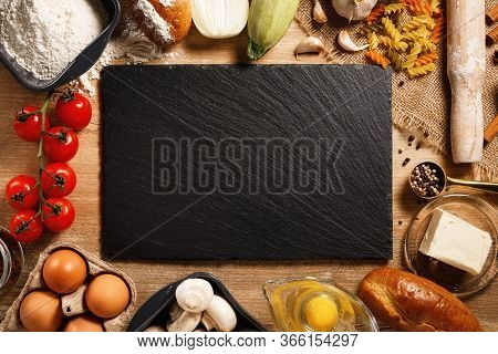 Tip View Board And Vegetables With On Kitchen Table. Cooking Classes Concept. With Copy Space.