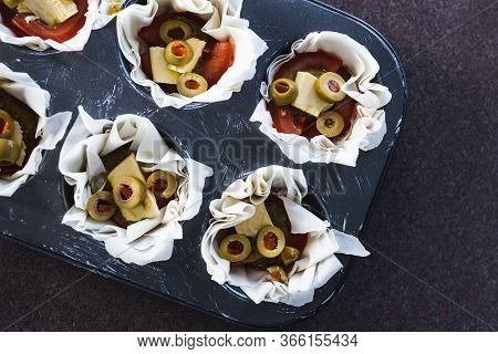 Plant-based Food, Filo Pastry Cups With Vegan Filling Made Of Tomatoes Olives Pesto And Dairy-free C
