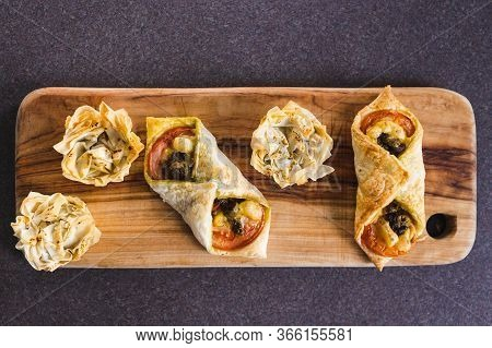 Plant-based Food, Filo Pastry Cups And Puff Pastry Envelopes With Vegan Cheese Pesto And Tomato Fill