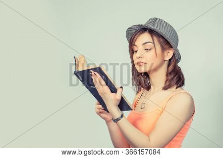 Serious Woman Holding Black Book Looking At It Interested, With High Interest Teenage Hipster Girl I