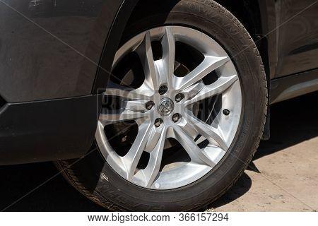 Novosibirsk/ Russia - May 03 2020: Brilliance V5, Car Wheel On Gray  Car - Close Up