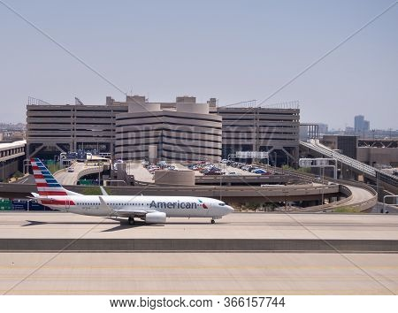 Phoenix,Az/USA -5.28.16 COVID-19 cases surge at American Airlines ramps at Phoenix Sky Harbor Airport, 70 ground crew workers have tested positive as of April,27th, 2020.