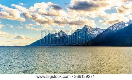 Sunset Over The Teton Mountain Range And Jackson Lake In Grand Teton National Park, Wyoming, United