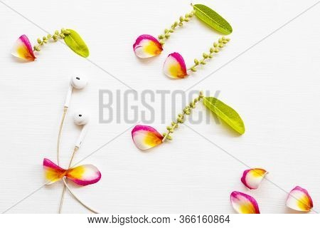 White Earphone Of Listening With Petal Flowers Frangipani Arrangement Music Score Flat Lay Style Of